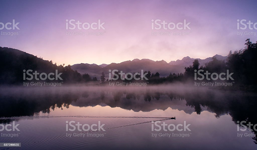 Mirror-like Lake Matheson In New Zealand stock photo