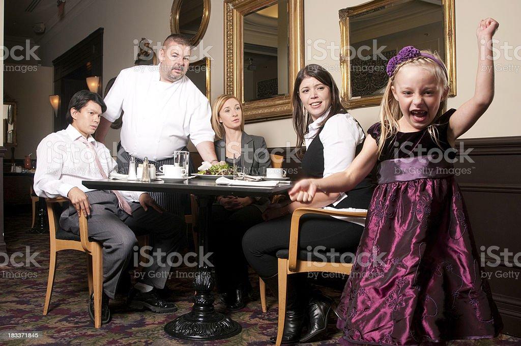 Misbehaving Girl in Restaurant stock photo