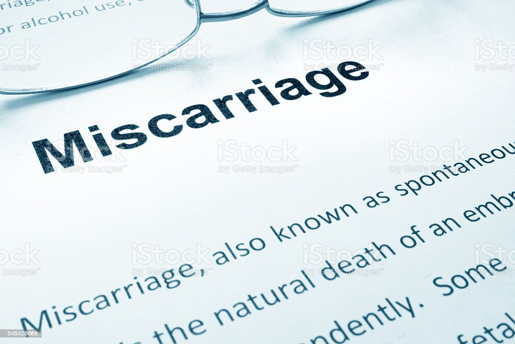 Miscarriage sign on a paper and glasses. stock photo