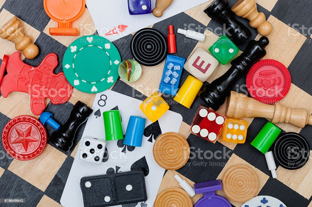 Miscellaneous board game pieces on a chess board stock photo
