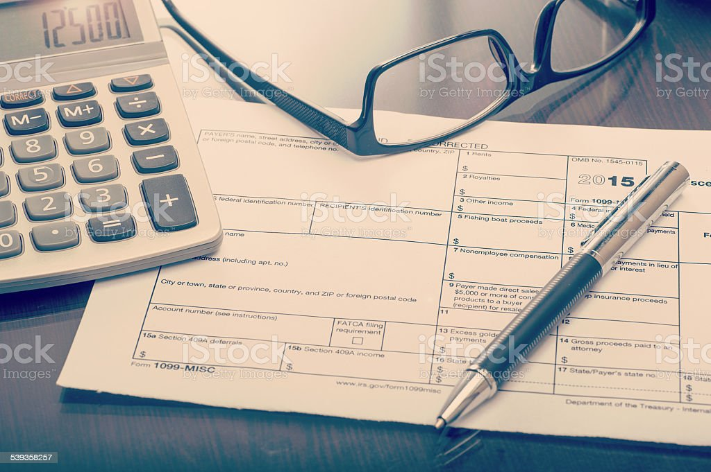 Miscellaneous income form on desk stock photo