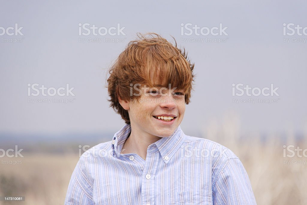 Mischievous Teenage Boy Laughing royalty-free stock photo
