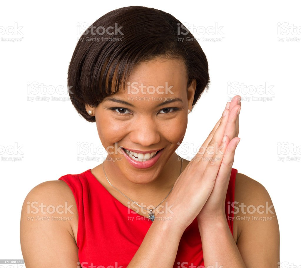 Mischievous Young Woman Rubbing Hands Together royalty-free stock photo