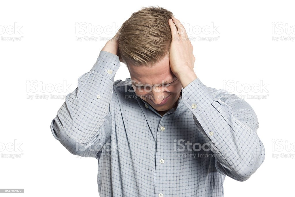 Miserable businessman with hands at head showing grief. stock photo