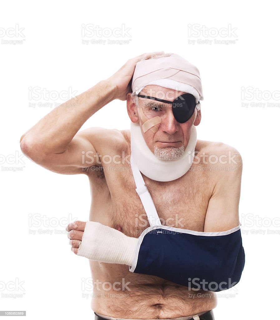 Miserable old man with multiple injuries royalty-free stock photo