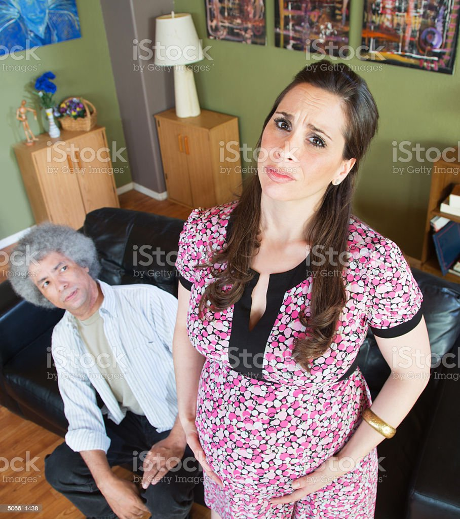 Miserable Pregnant Woman with Husband stock photo