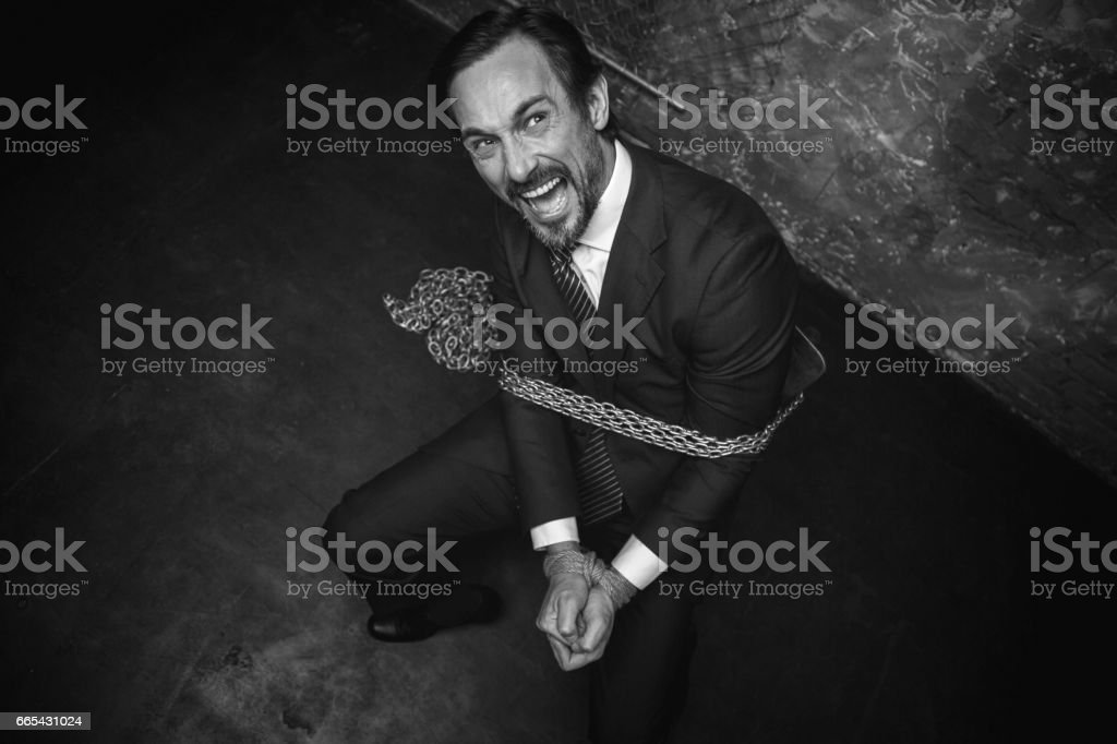 Miserable scared businessman screaming for help stock photo