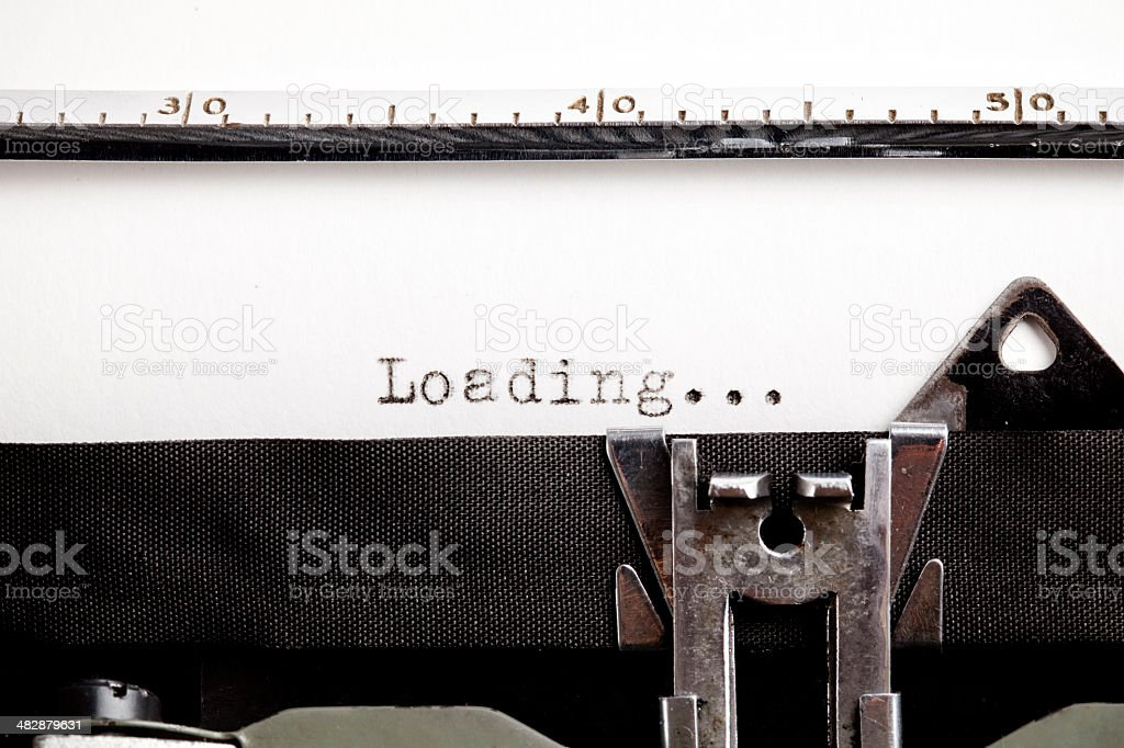"Mismatch technology, ""Loading"" in an old typewriter royalty-free stock photo"