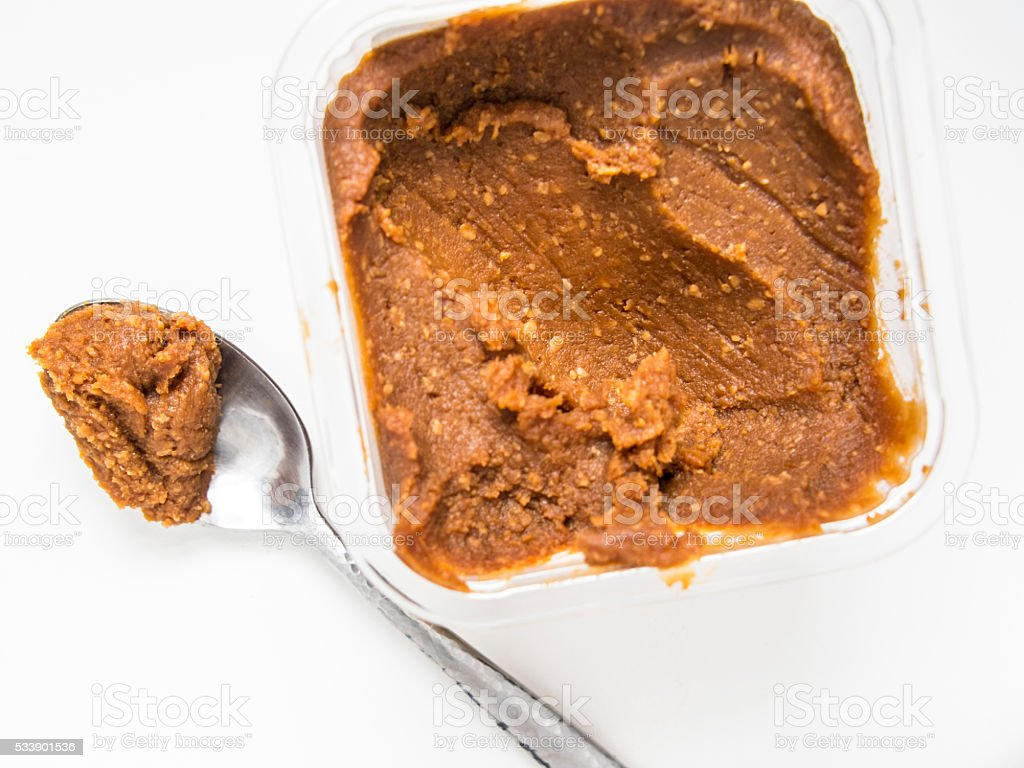 Miso Paste Container with Spoonful stock photo