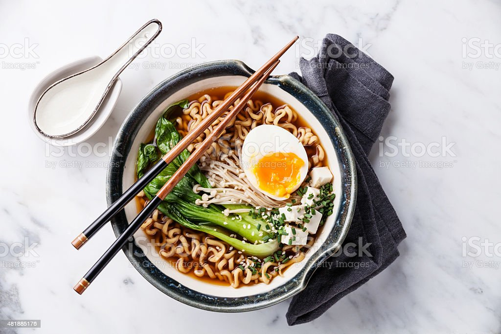 Miso Ramen Asian noodles with egg, enoki and pak choi stock photo
