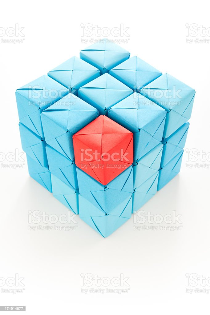 Misplaced red cube stock photo