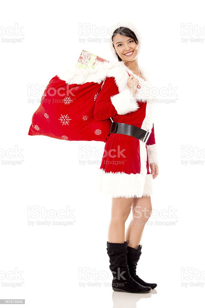 Miss Claus carrying a gift sack royalty-free stock photo