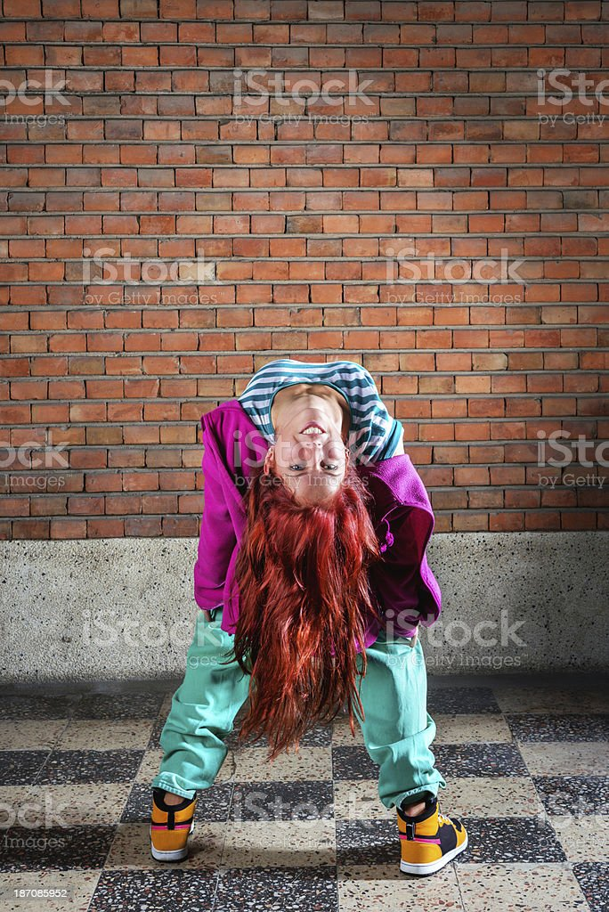 Playful Young Woman Upside Down Tooth Smiling and Looking at the...