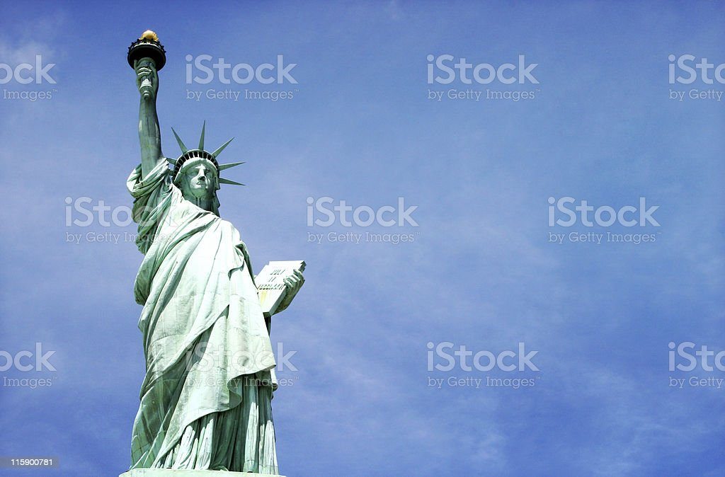 miss liberty on blue stock photo