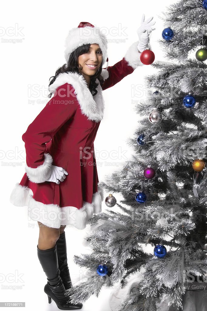 Miss Santa Claus Decorating Tree royalty-free stock photo