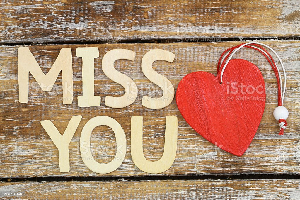 Miss You Written With Wooden Letters And Red Wooden Heart Stock