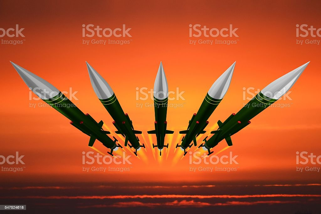 Missiles flying in the air, attack, aggression stock photo