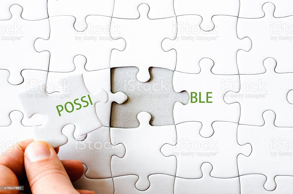 Missing jigsaw puzzle piece completing word POSSIBLE stock photo