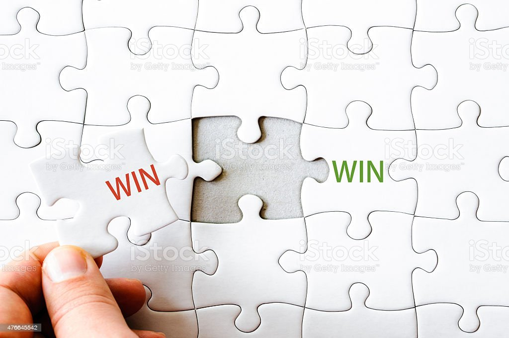 Missing jigsaw puzzle piece completing word WIN stock photo