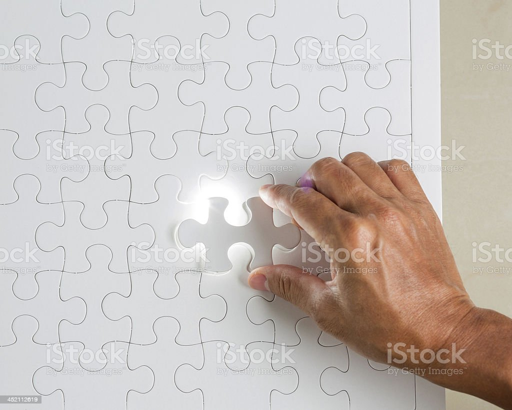 Missing jigsaw puzzle piece with light glow royalty-free stock photo