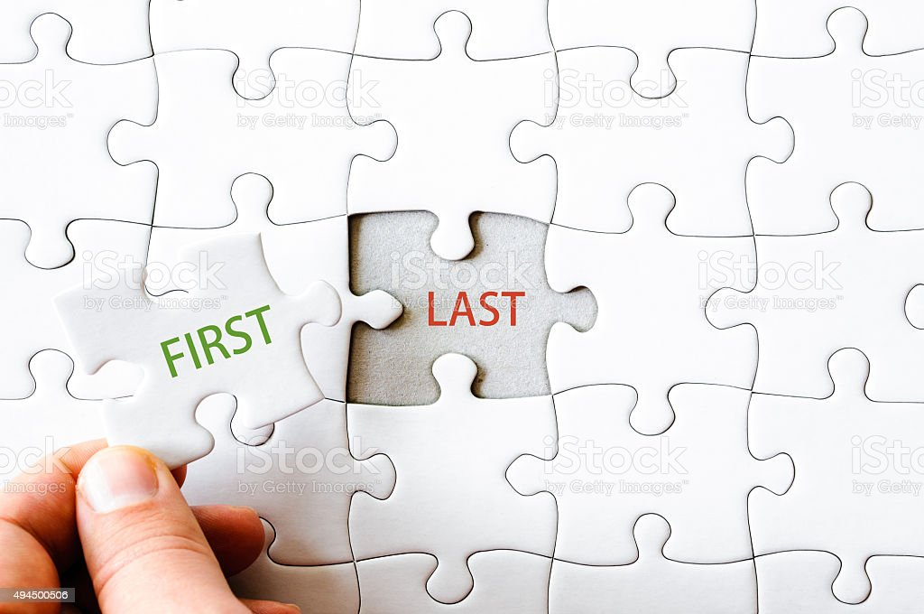 Missing jigsaw puzzle piece with word FIRST stock photo