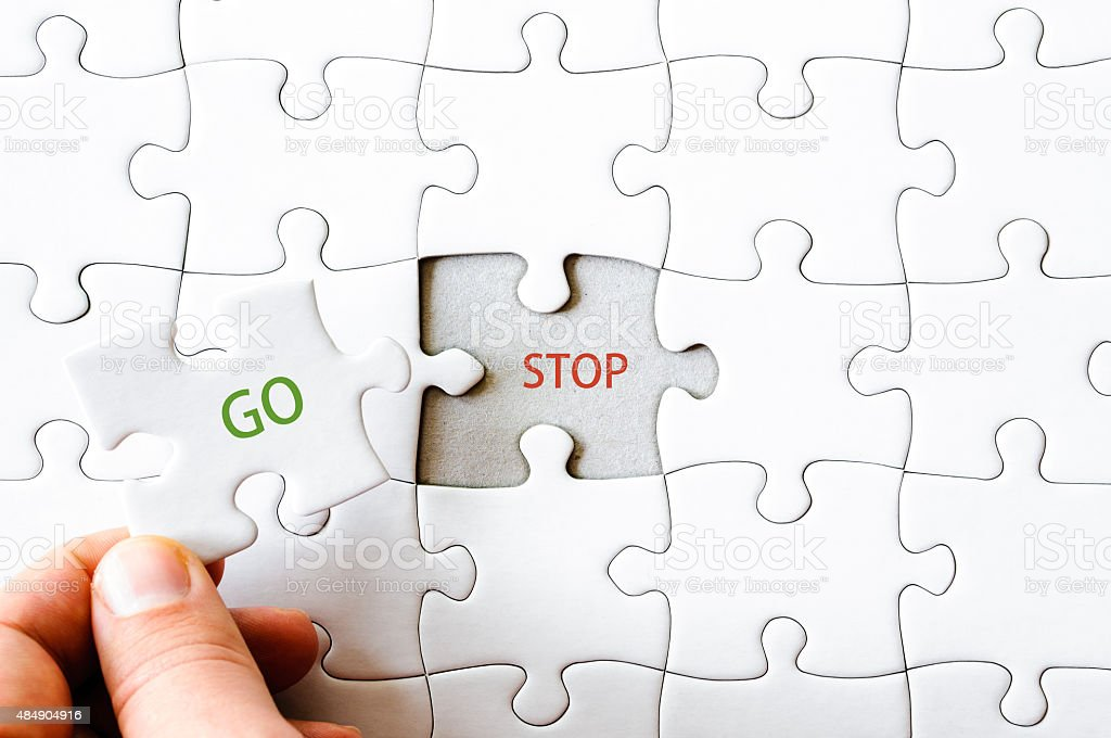 Missing jigsaw puzzle piece with word GO stock photo