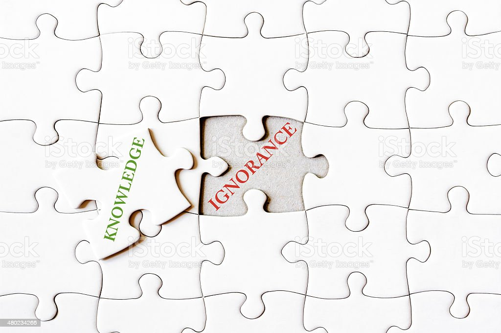 Missing jigsaw puzzle piece with word KNOWLEDGE stock photo