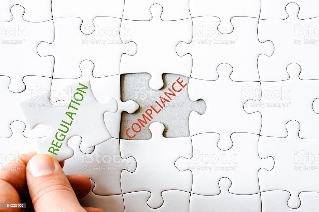 Missing jigsaw puzzle piece with word REGULATION stock photo