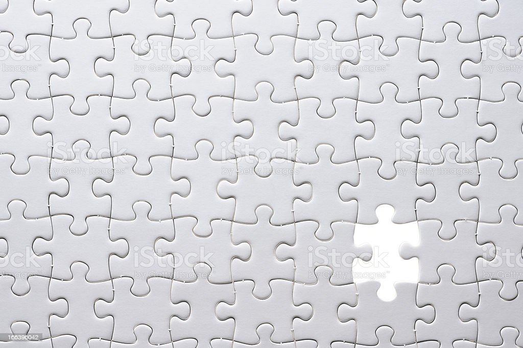 Missing piece of a blank puzzle with light from behind royalty-free stock photo