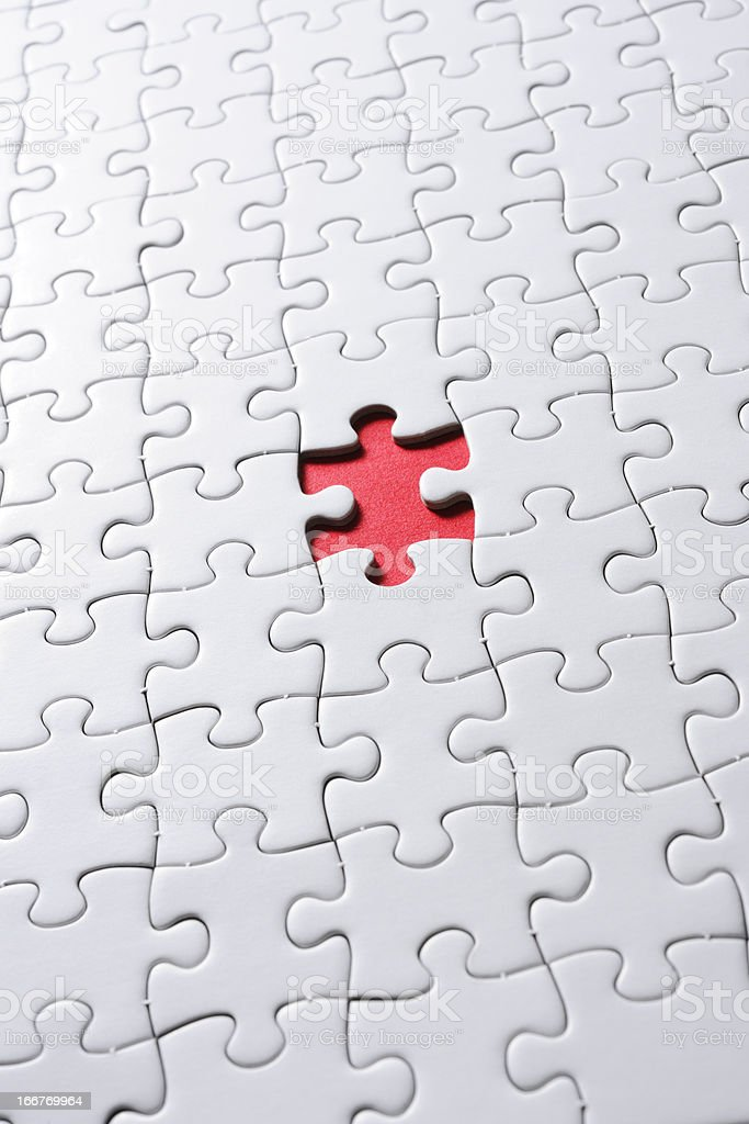 Missing piece of blank white Jigsaw puzzle against red background royalty-free stock photo