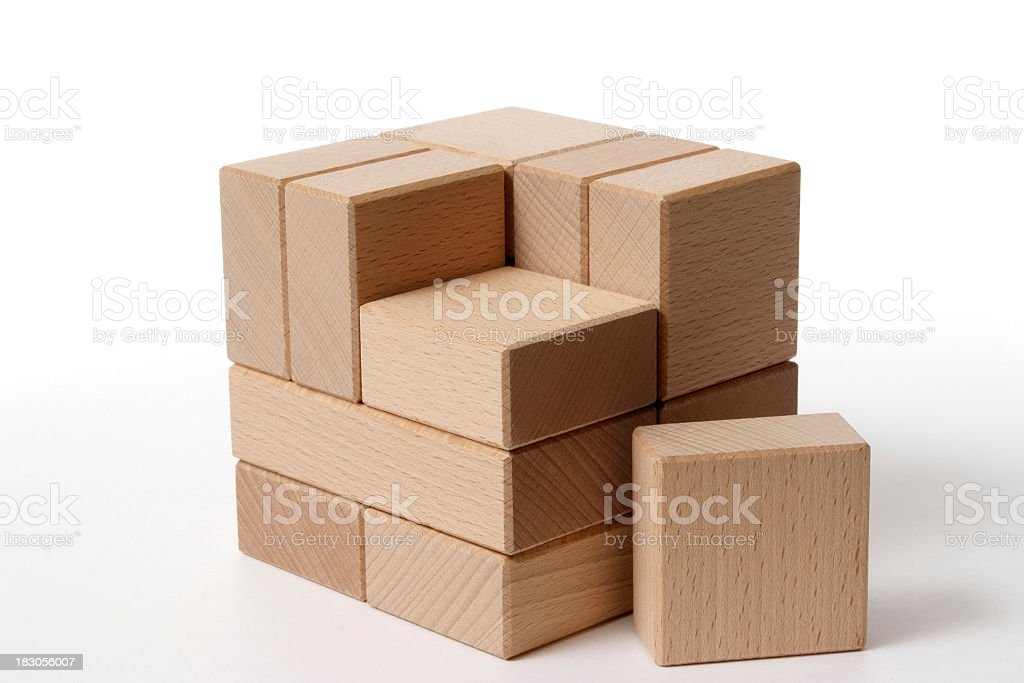 Missing piece of cube block on white background royalty-free stock photo