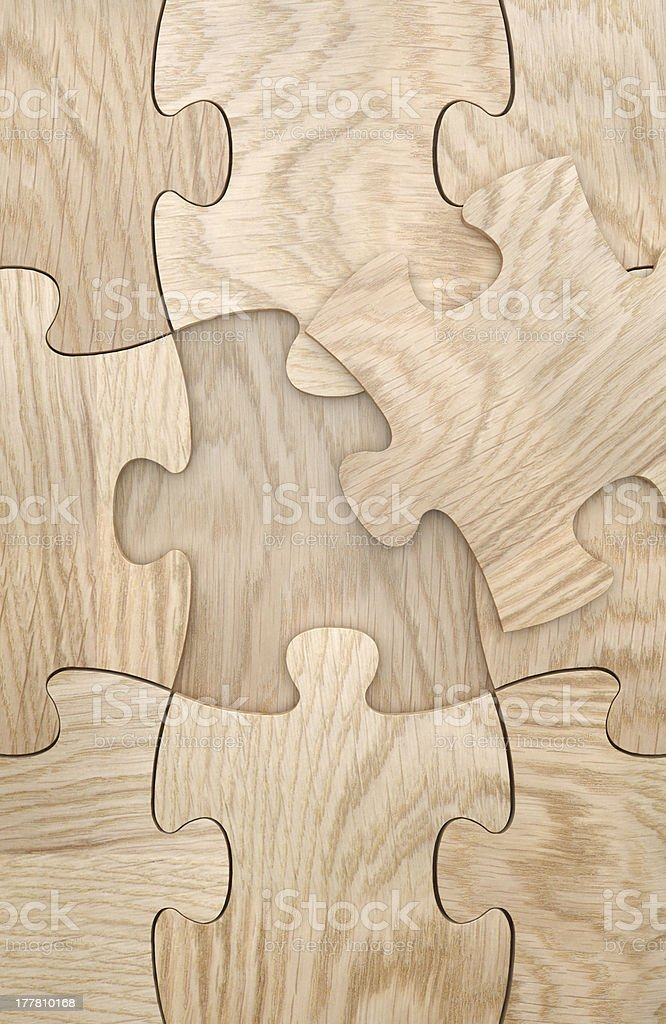 Missing puzzle element wooden background