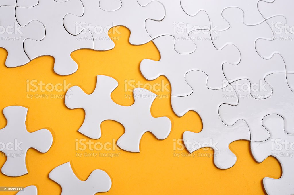 Missing Puzzle on Yellow Background, Searching a Solution Concept stock photo
