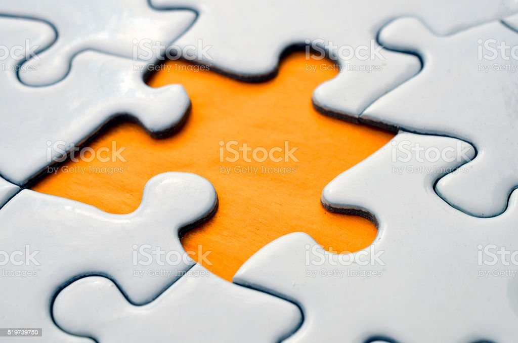 A close up image of a missing puzzle piece.