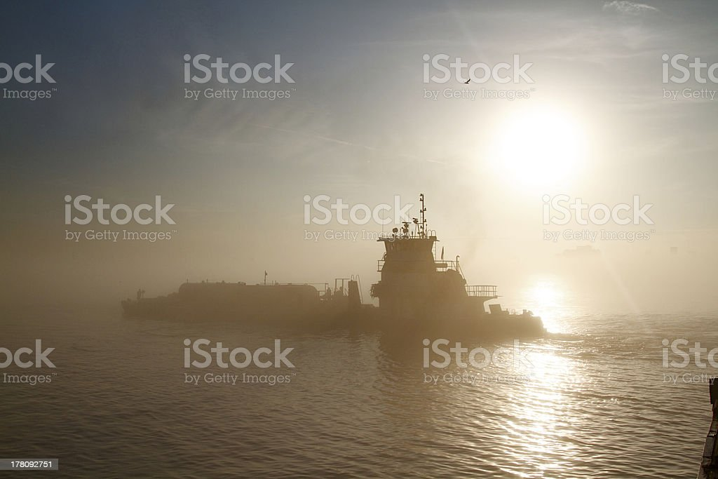 Mississippi River barge in the Morning Fog royalty-free stock photo