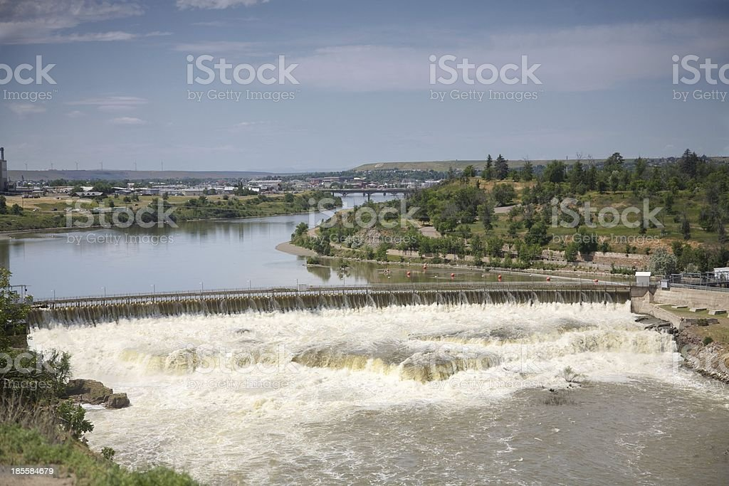 Missouri River flows over The Great Falls Dam stock photo
