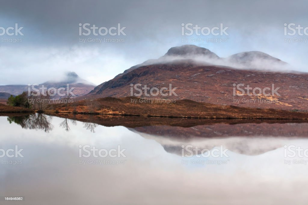 Mist covered mountains in the Highlands Scotland stock photo