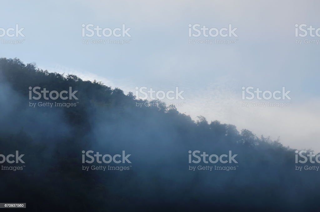 mist floating and cover mountain slope stock photo