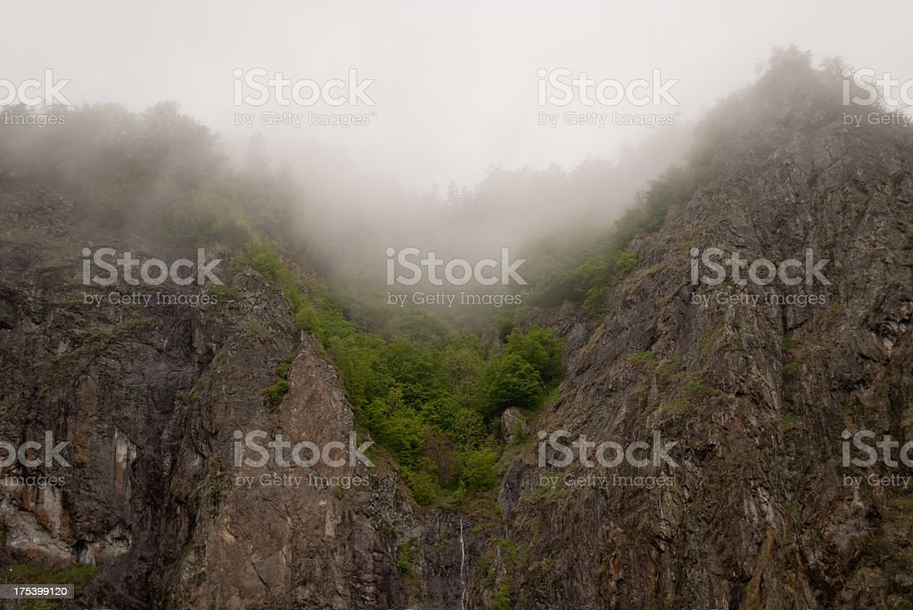 Mist in Carpathian cliffs stock photo