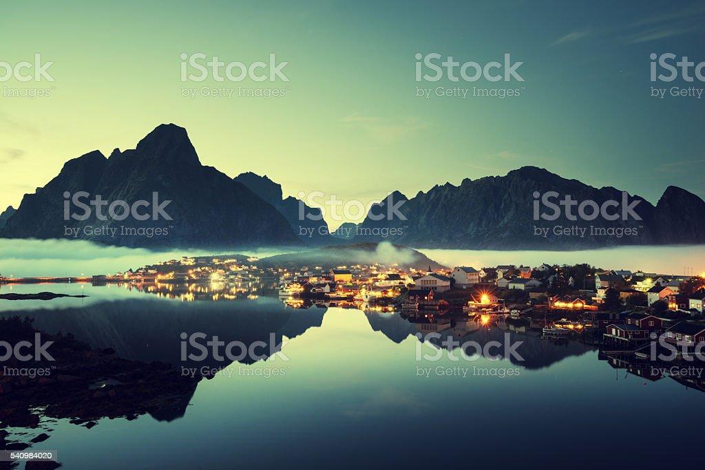 mist in sunset time Reine Village, Lofoten Islands, Norway stock photo