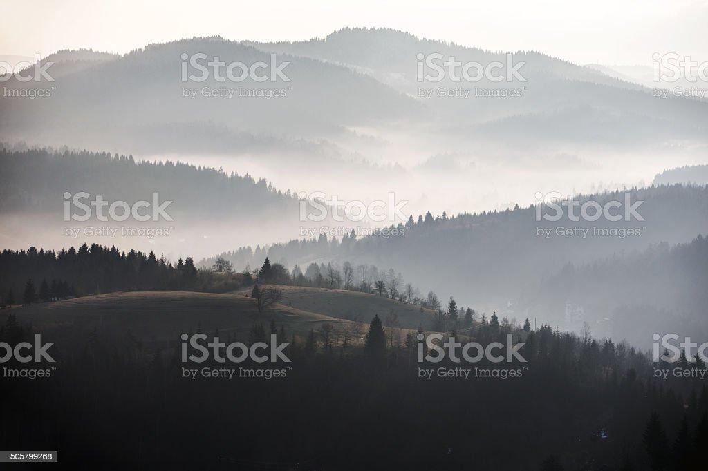 Mist over mountains stock photo