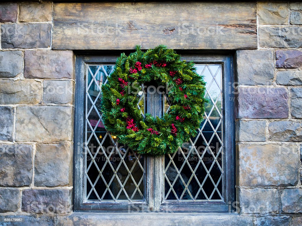 Mistletoe decoration on vintage window, wall stone stock photo