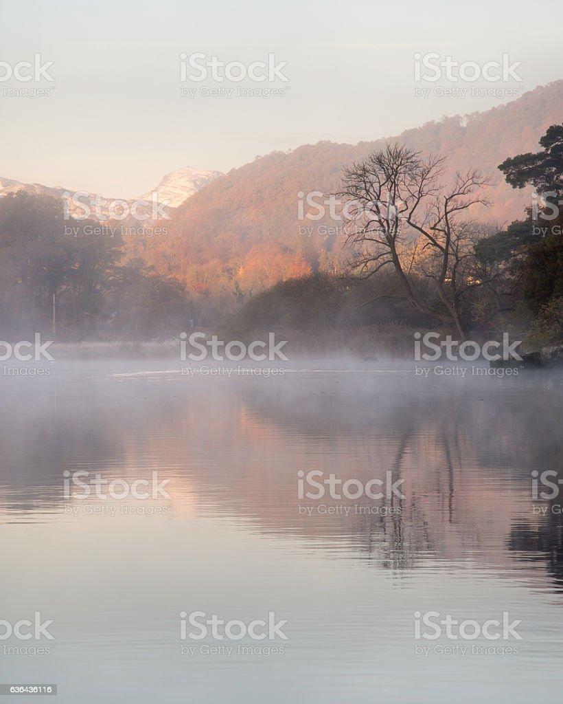 Misty autumn morning on Windermere lake stock photo