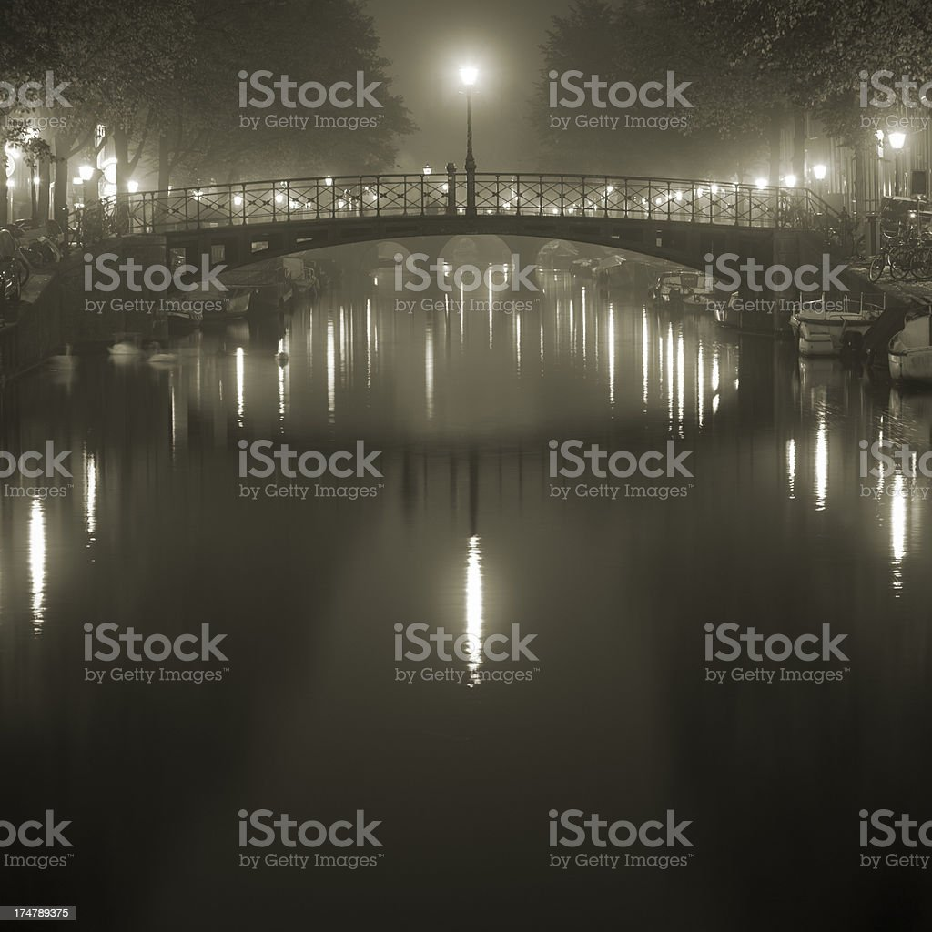 Misty bridge in Amsterdam's red light district royalty-free stock photo