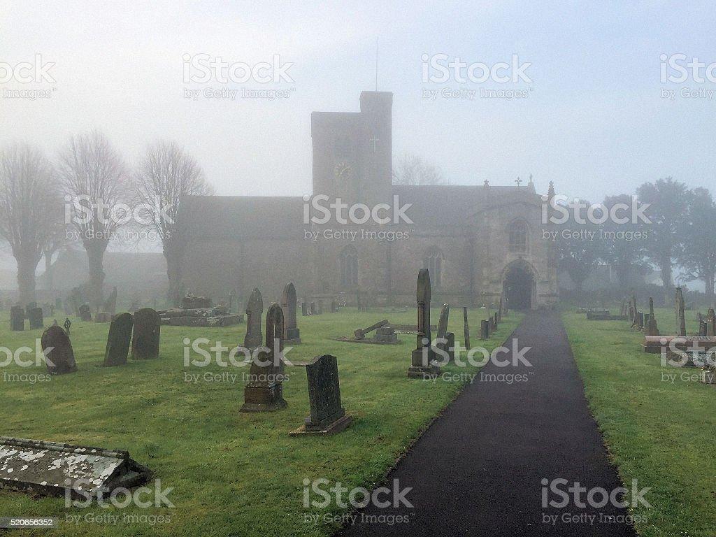 Misty churchyard stock photo