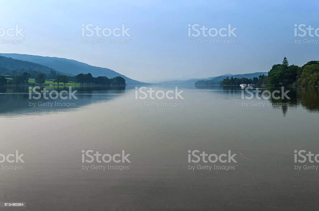 Misty Coniston Water, flat, calm, early autumn, soft colours stock photo