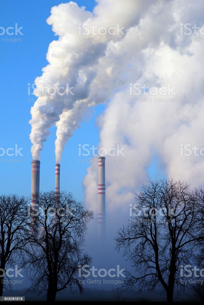 misty day and steaming coal power plant stock photo