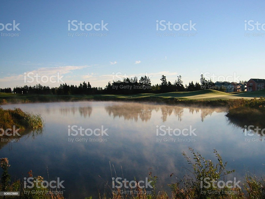Misty golf course pond royalty-free stock photo