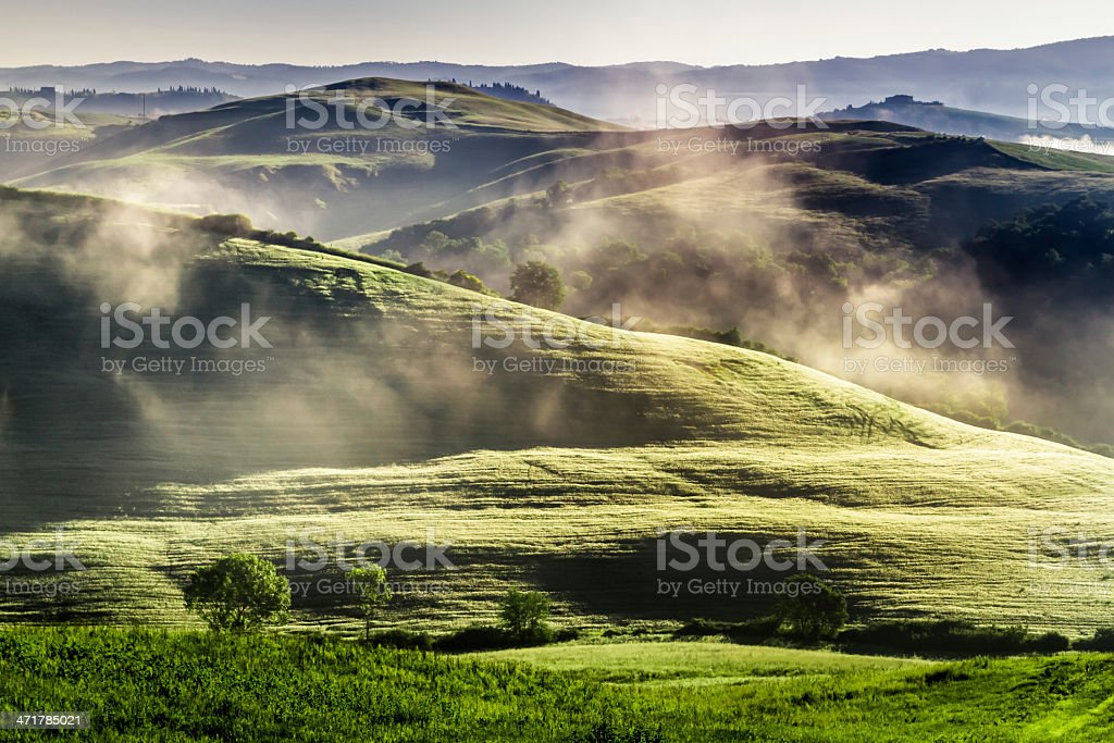 Misty hills in Tuscany at sunrise royalty-free stock photo