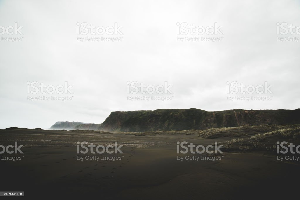 Misty Karekare Beach stock photo